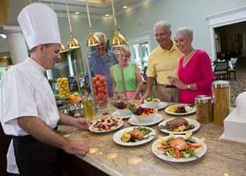 Residents having quality food service at Discovery Village At Dominion in San Antonio, Texas