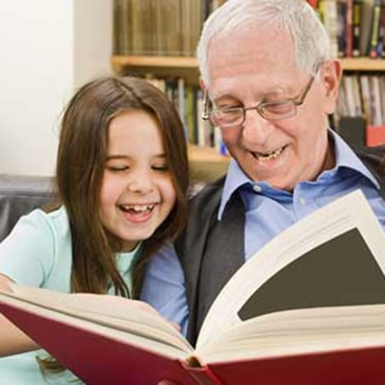 Resident reading to grand kids at West Fork Village in Irving, Texas