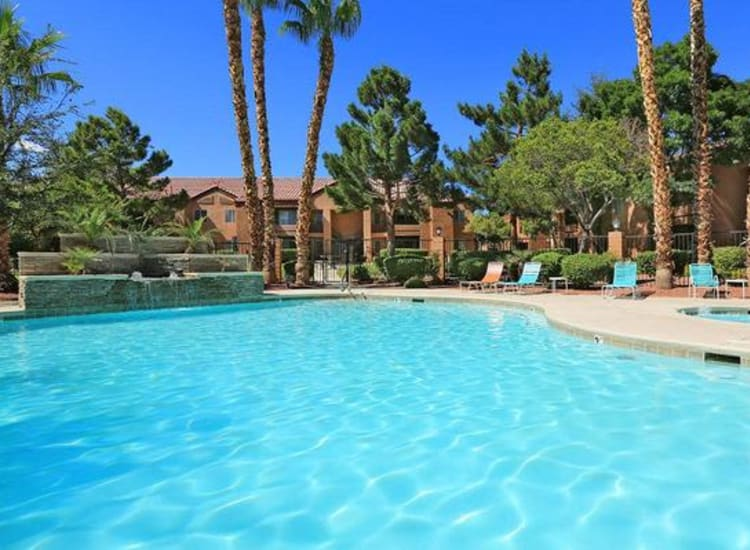 Resort-style swimming pool with a fountain and spa at Alterra Apartments in Las Vegas, Nevada