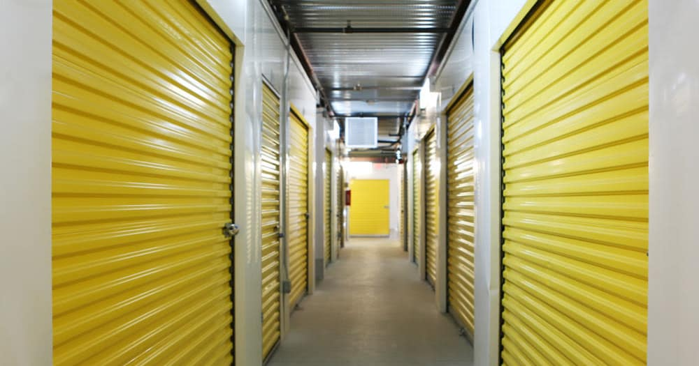 Storage units with yellow doors at StoreSmart Self-Storage in Conway, Arkansas