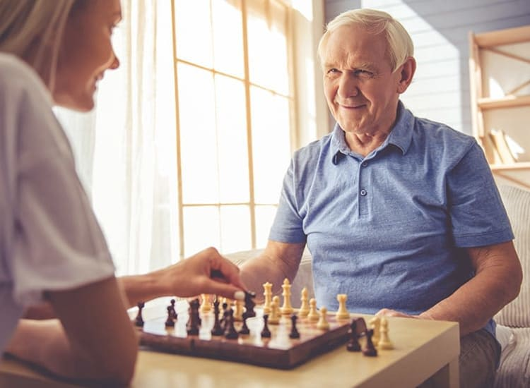 A resident partaking in a particularly exciting and competitive chess match at Ashbrook Village in Duncan, Oklahoma.