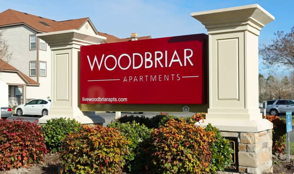 Monument sign at Woodbriar Apartments in Chesapeake, Virginia