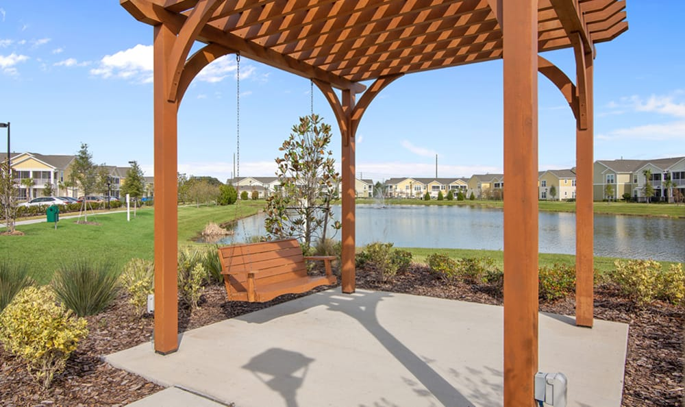 relaxing pergola and pond at Springs at Tapestry in Kissimmee, FL
