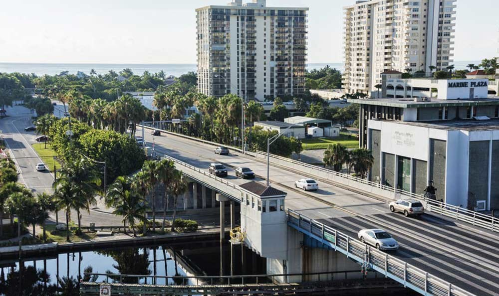 Street view with cars at The Meridian at Waterways in Fort Lauderdale, Florida.