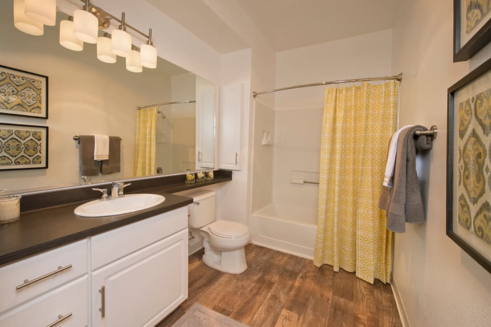 Bathroom with hardwood flooring at Rosewalk in San Jose, California
