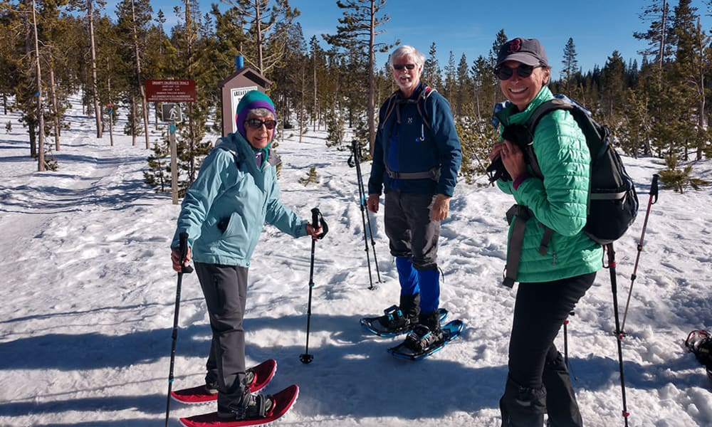 Residents from Touchmark at Mount Bachelor Village in Bend, Oregon snowshoeing