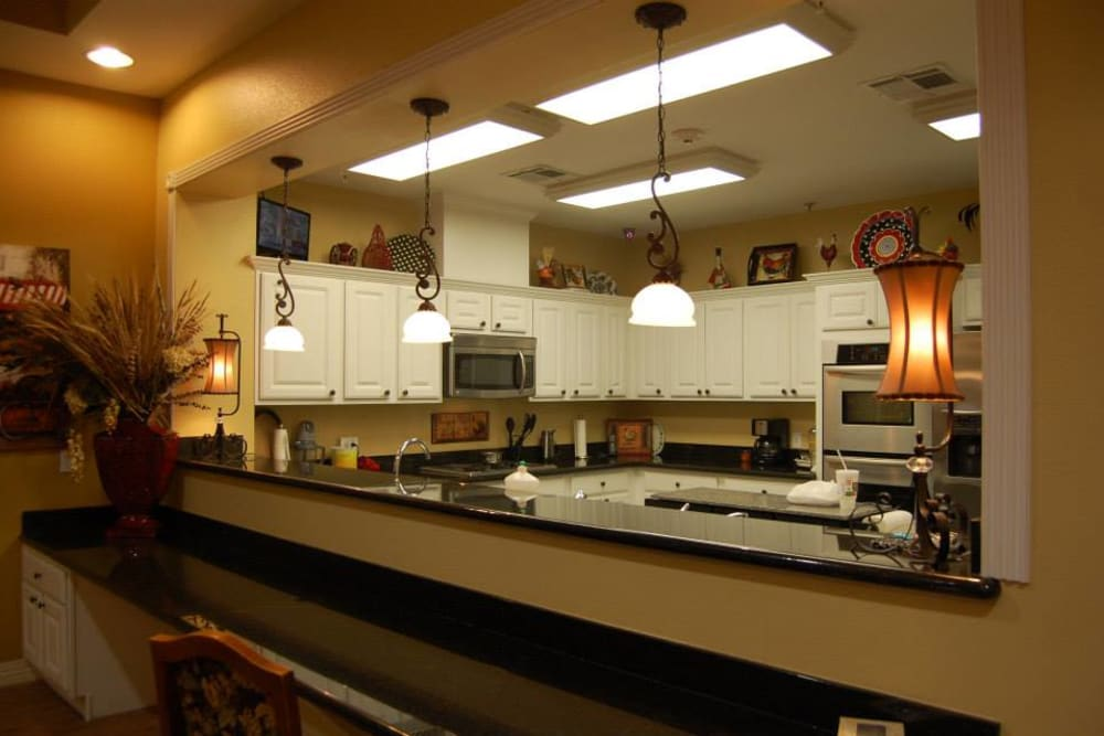 A large community kitchen at Autumn Grove Cottage at Pearland in Manvel, Texas