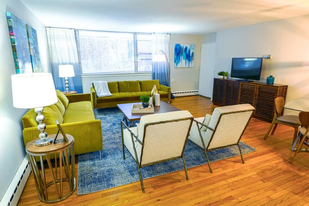 Large open living room waiting for your furniture at Cherokee Apartments in Philadelphia, PA