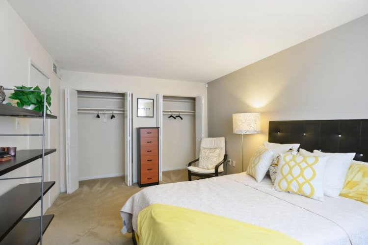 Well-decorated bedroom with plush carpeting in a model home at Capital Crossing in Suitland, Maryland