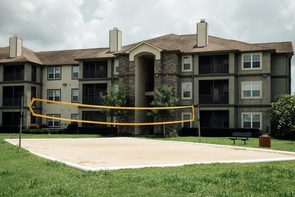 A volleyball court and apartments at Belmere Luxury Apartments in Houma, LA.