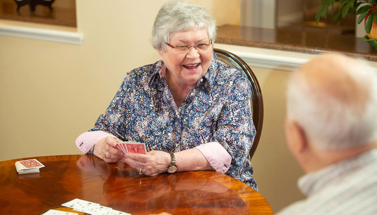 senior residents playing a card game