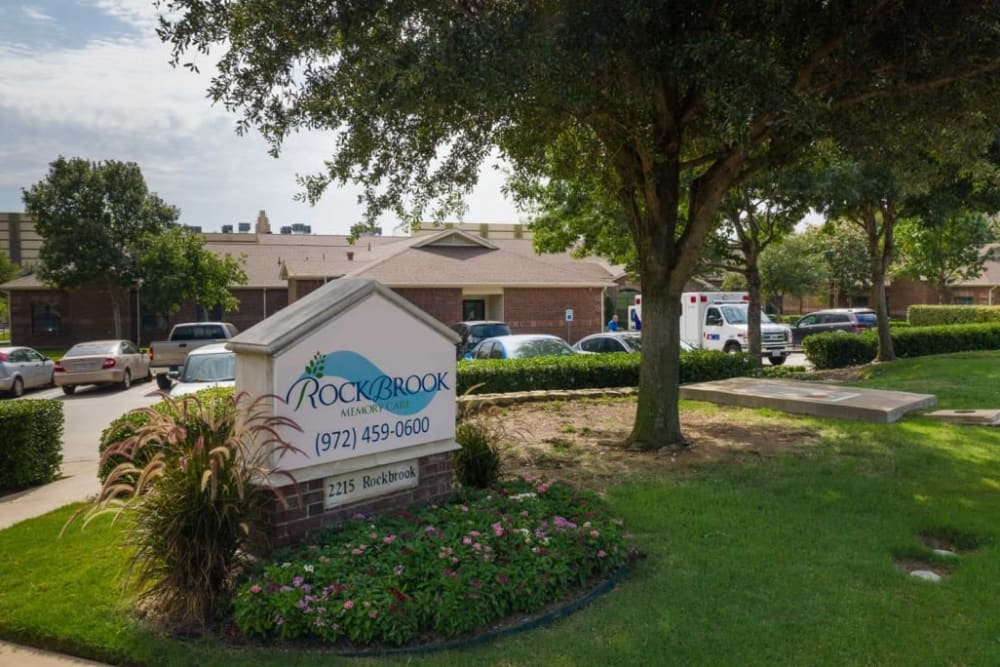 Entrance sign at RockBrook Memory Care in Lewisville, Texas