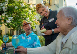 Two seniors ordering food at Summerfield Senior Living in Bradenton, Florida