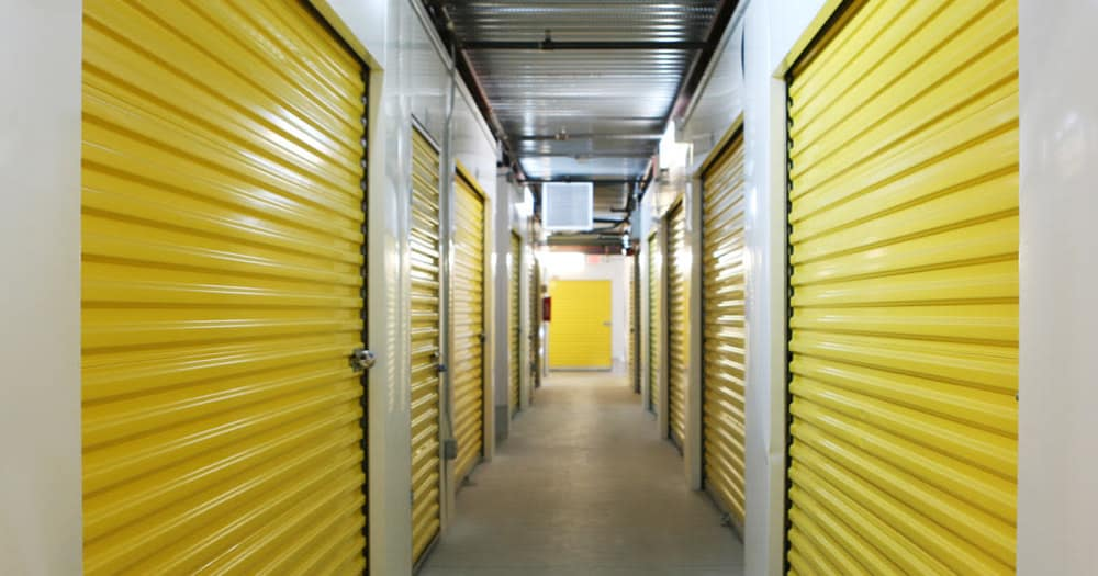Storage units with yellow doors at Midgard Self Storage in Naples, Florida