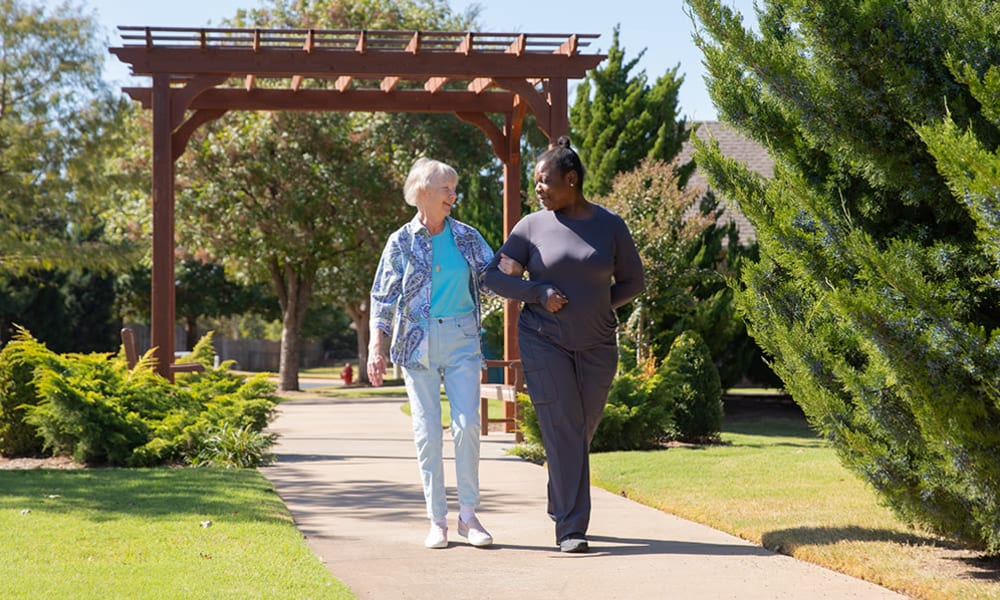 A memory care resident outdoors walking at Touchmark at Mount Bachelor Village in Bend, Oregon