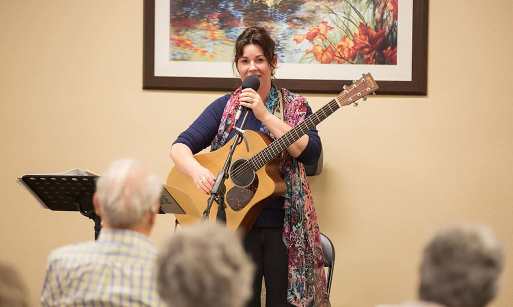 A musician entertaining residents at Touchmark at Mount Bachelor Village in Bend, Oregon.