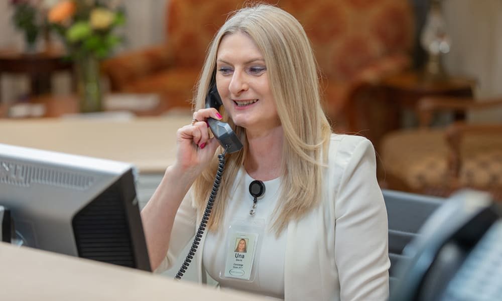 Team member from Touchmark at Wedgewood in Edmonton, Alberta answering the telephone