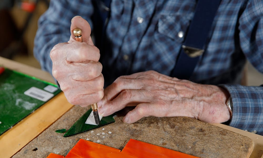 A resident enjoying handywork at Touchmark at All Saints in Sioux Falls, South Dakota