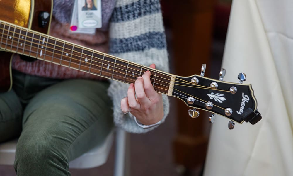 A guitarist entertains residents from Touchmark at All Saints in Sioux Falls, South Dakota