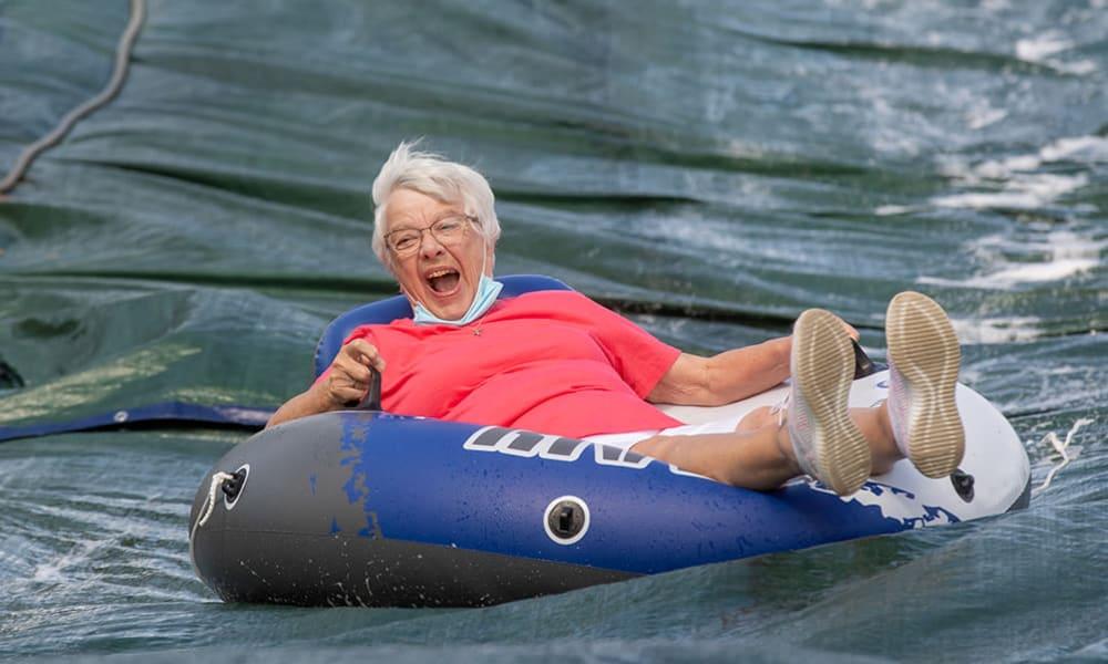 Residents enjoying outdoor slip and slide.