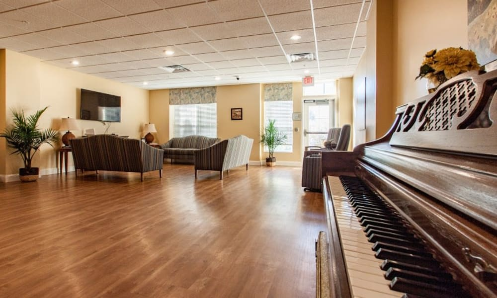 A piano and seating in the memory care area at Keystone Place at Forevergreen in North Liberty, Iowa