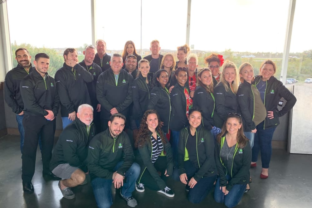 Group of staff in matching jackets at Inspired Living Royal Palm Beach in Royal Palm Beach, Florida.