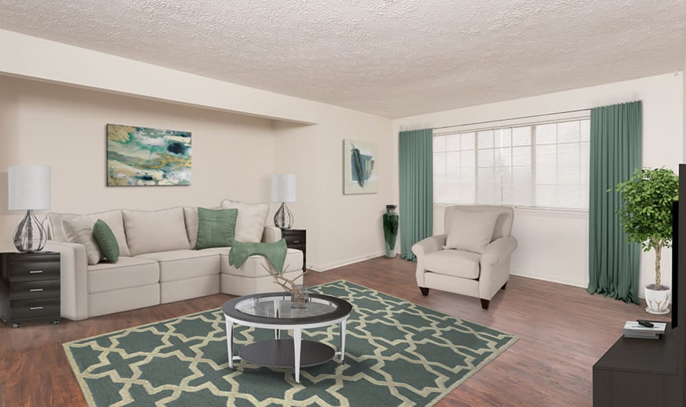 Living Room with green accents at Waverlywood Apartments & Townhomes in Webster, New York