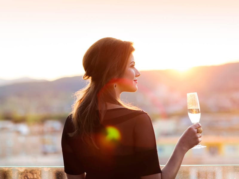 Woman enjoying a glass of champagne at EVR Spur Cross in Queen Creek, Arizona