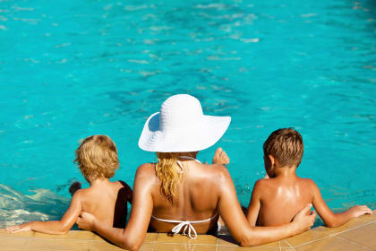 Family enjoying a swimming pool near Avenue 25 Apartments