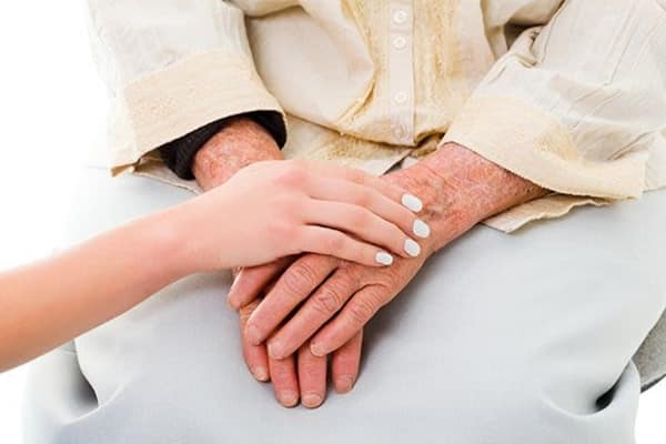 Lady holding hands with a resident at The Retreat at Carolina Bay in Hartsville, South Carolina