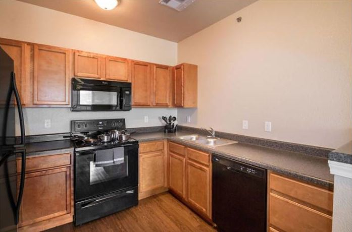 Spacious kitchen with Wood-Style Flooring at The Reserves at Brookside in Borger, Texas