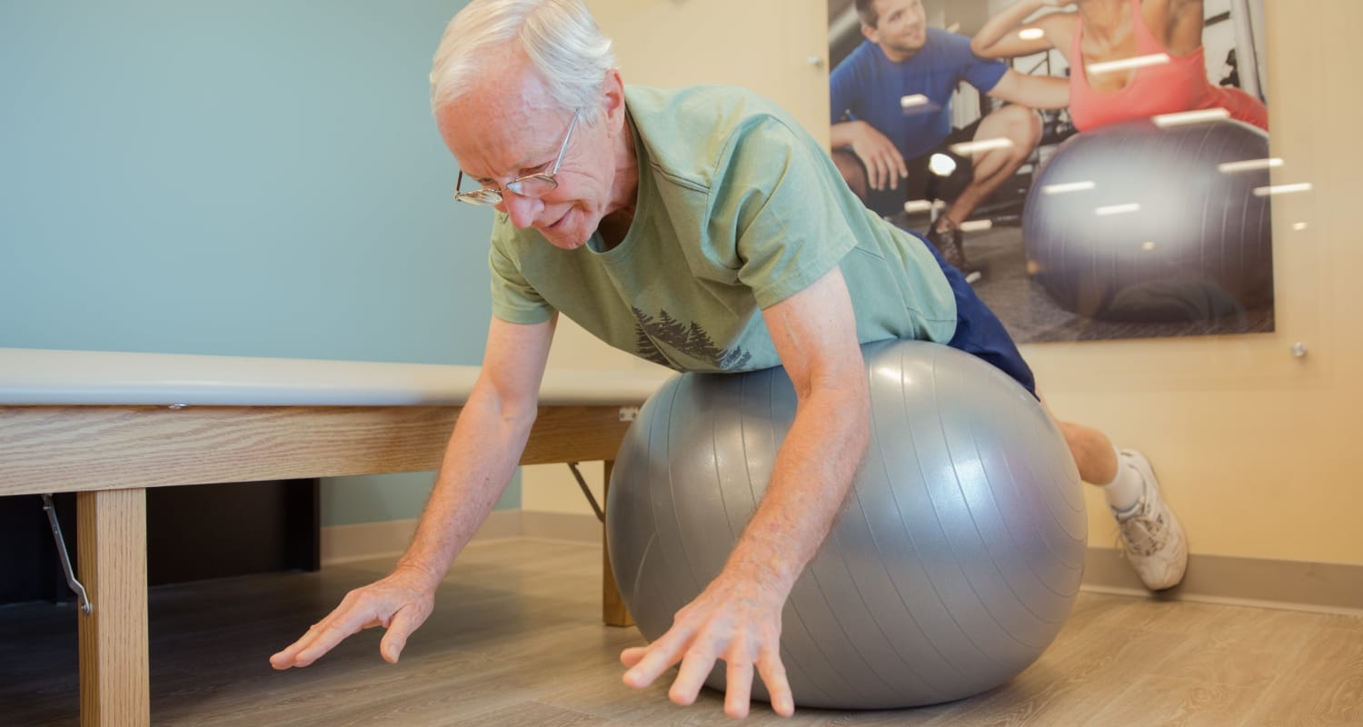 A resident on a yoga ball at Touchmark at Fairway Village Health & Fitness Club in Vancouver, Washington