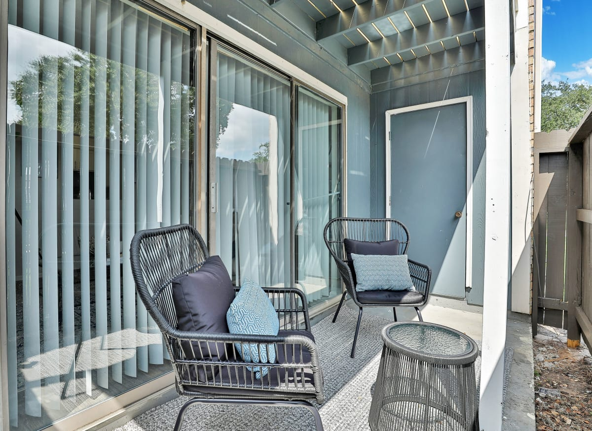 A spacious back porch with storage at Barringer Square in Webster, Texas