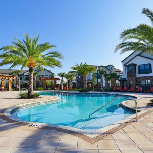 Resort-style swimming pool on a beautiful day at The Hawthorne in Jacksonville, Florida