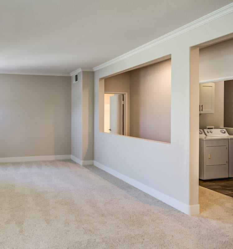 Plush carpeting and an in-unit washer and dryer in a model home at Sofi Westview in San Diego, California