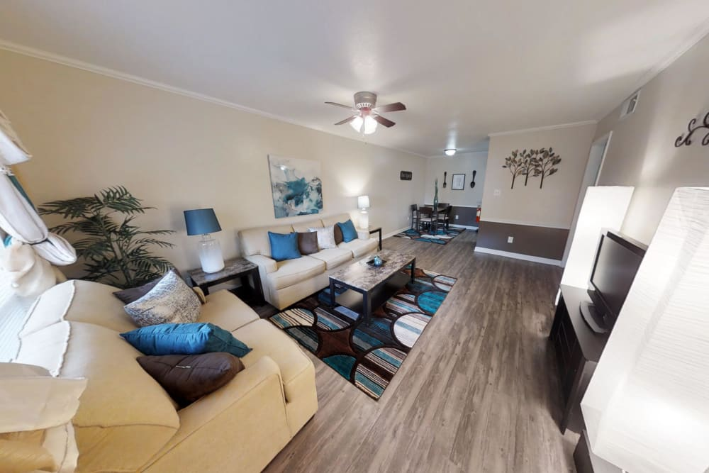 Living room at Falls of Maplewood Apartments in Houston, Texas