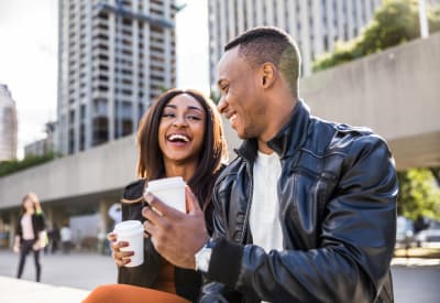Resident couple enjoying coffee while they take a break from shopping downtown near Foundations at River Crest & Lions Head in Sugar Land, Texas