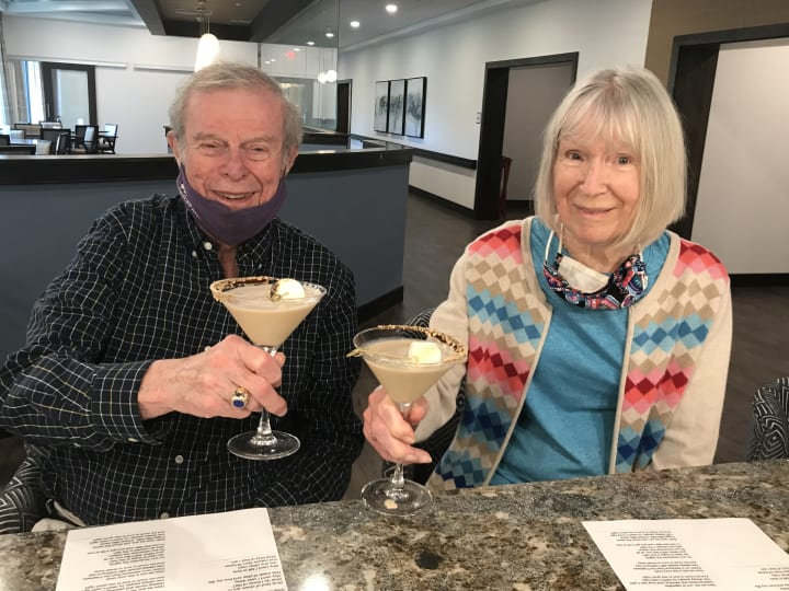 An Eagleview Landing couple enjoy some specialty smores cocktails.