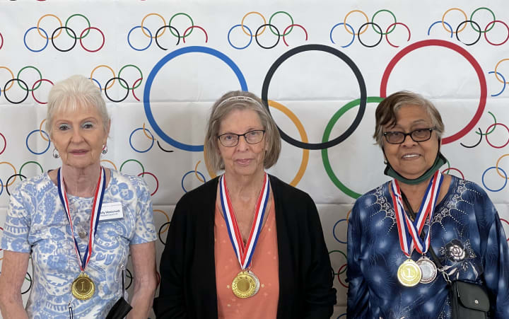 Residents at Solivita Marketplace got their photos taken after receiving their medals!