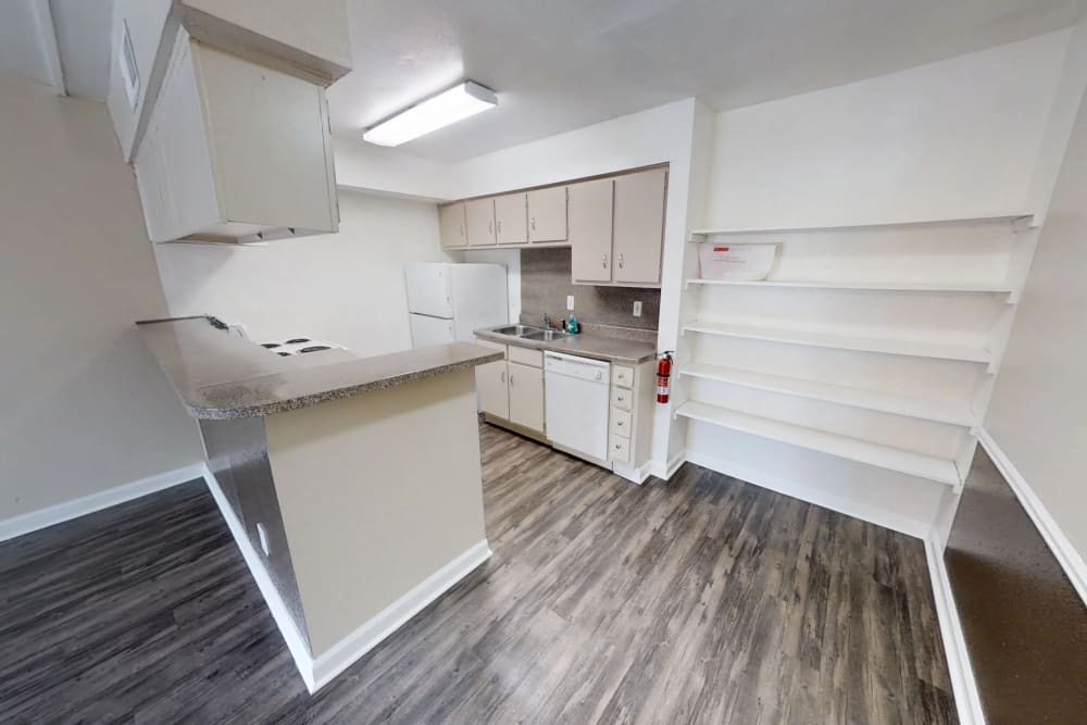 Well-lit kitchen at Falls of Maplewood Apartments
