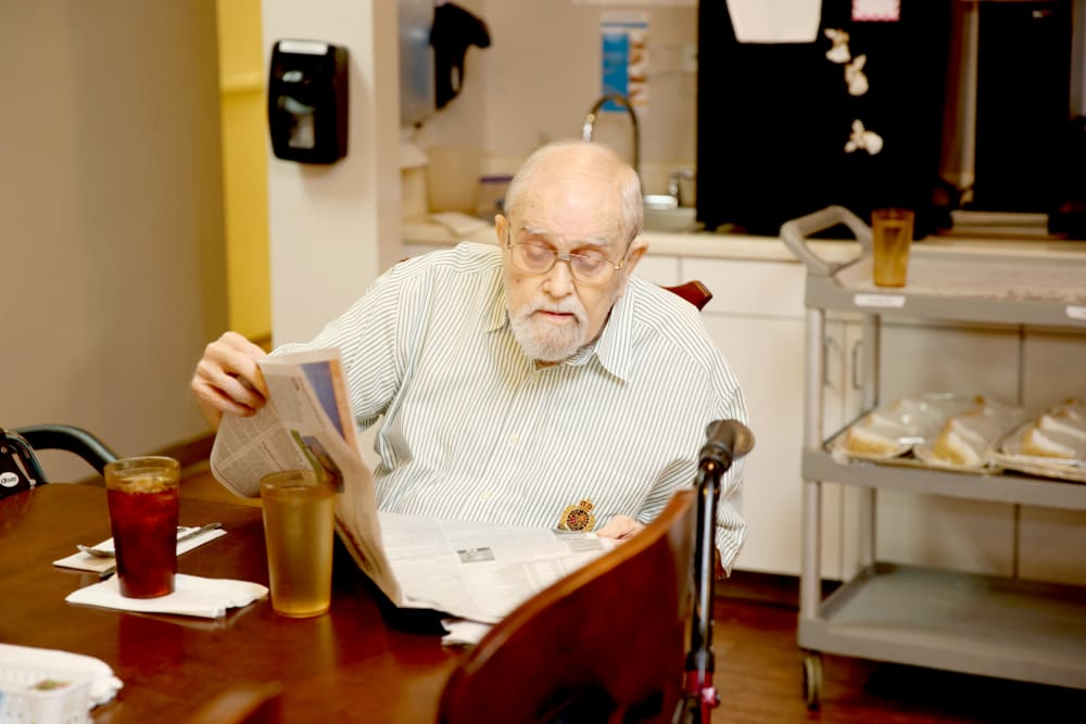 A resident reading the newspaper at Providence Assisted Living.