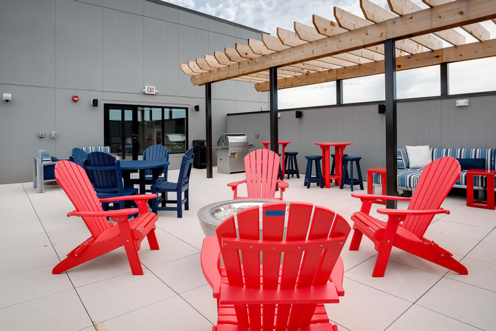Resident sundeck with comfortable seating and a grilling station at Lake Jonathan Flats in Chaska, Minnesota