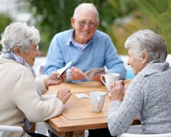 Senior residents playing cards at Kenmore Senior Living in Kenmore, Washington
