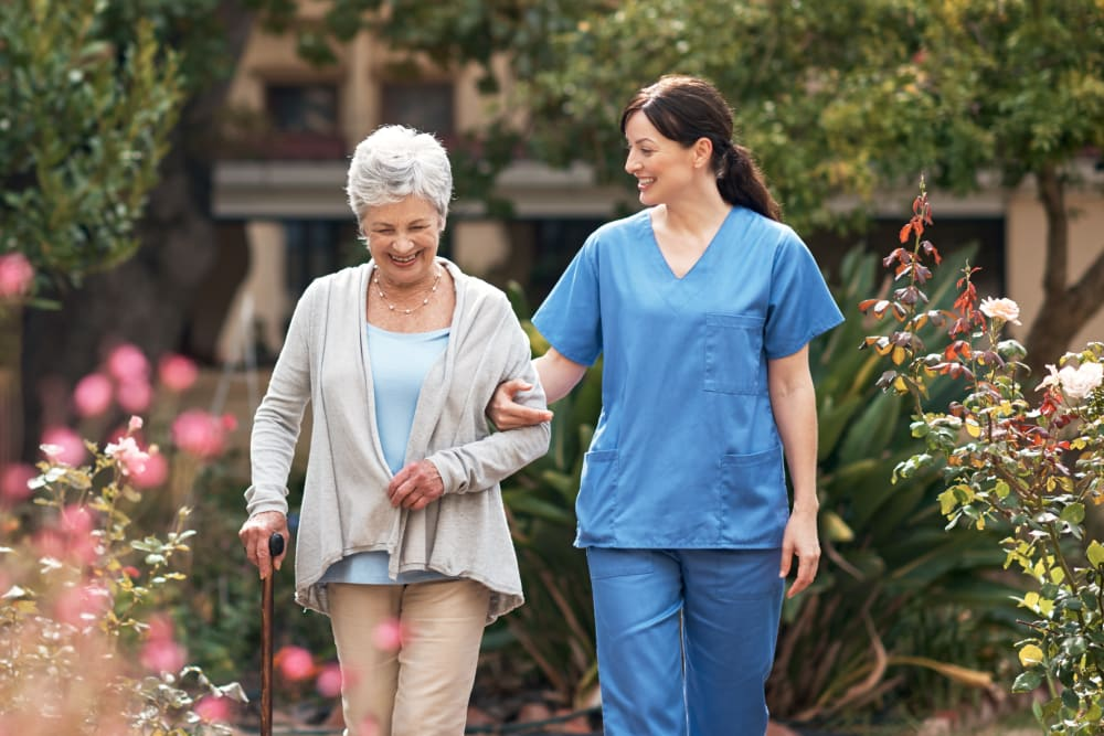 Resident and care giver out on a walk near Ray Stone Inc. in Sacramento, California