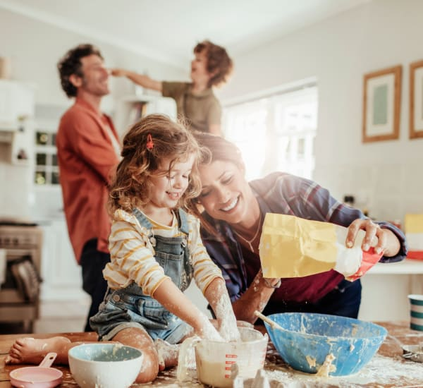 Family baking together at Olde Hampton Village Apartments in Hampton, New Hampshire