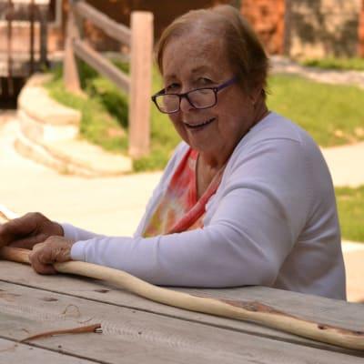 A resident enjoying the outside bench near {location_name}} in Burnsville, Minnesota