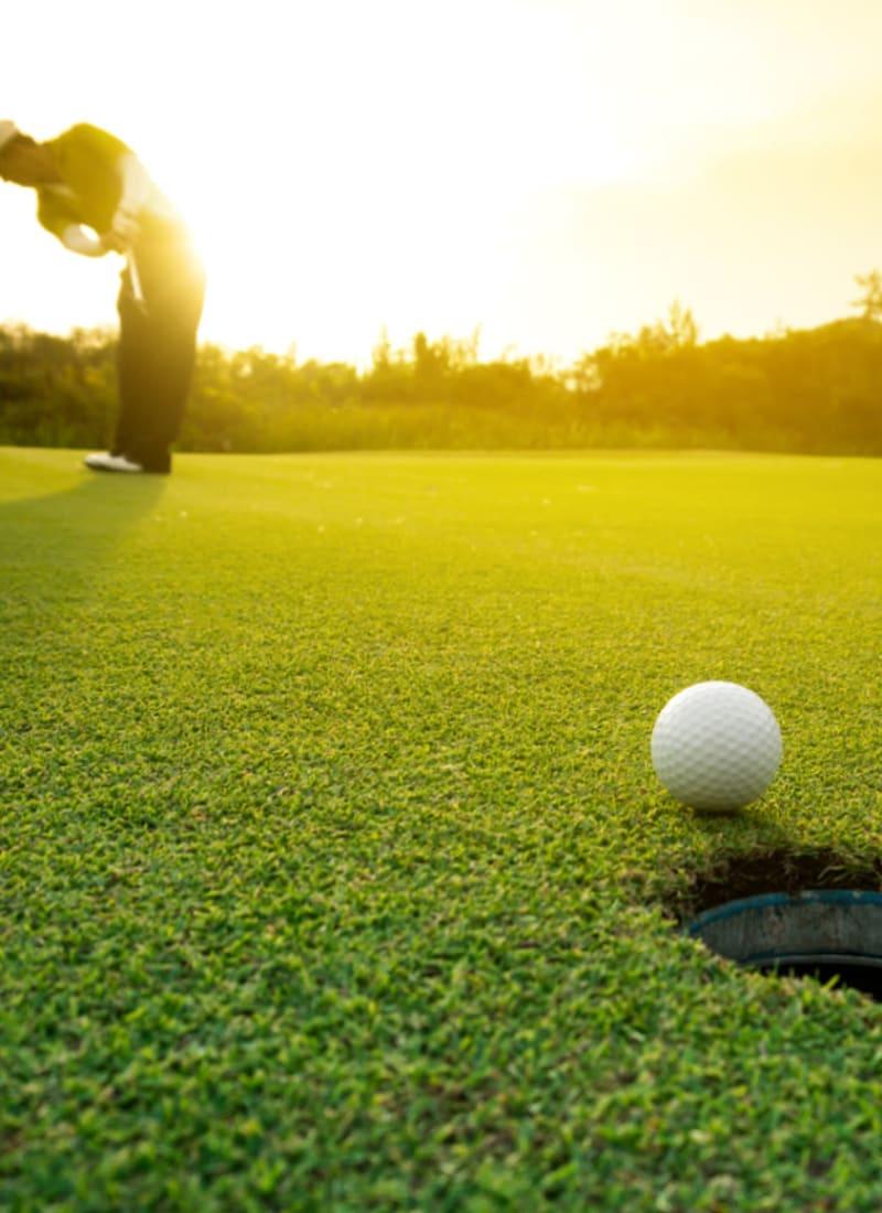 Golfer putting on green near Marquis at Sonoran Preserve in Phoenix, Arizona