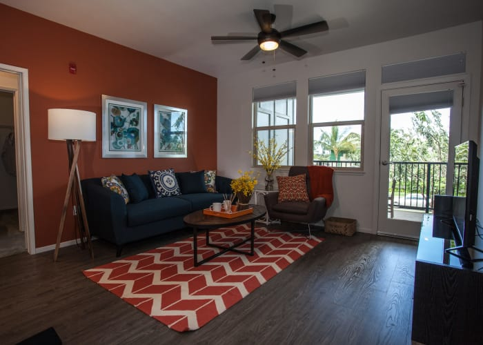 Living room with hardwood floors and ceiling fan at Kapolei Lofts in Kapolei, HI