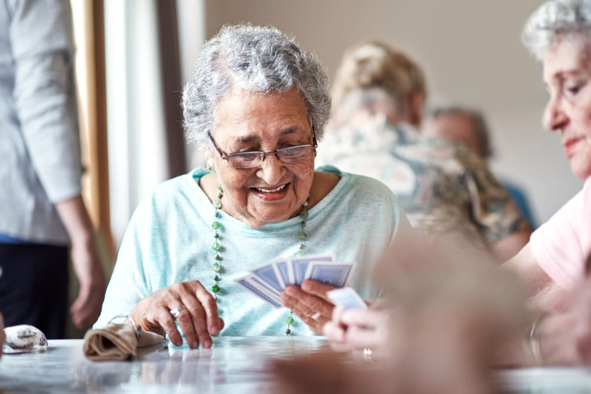 Resident happily playing cards at Madison House in Norfolk, Nebraska