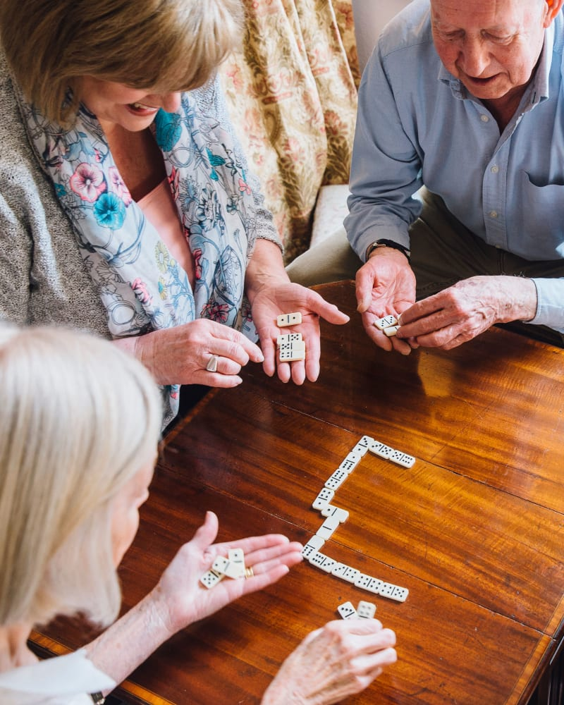 Residents playing dominoes at Randall Residence of McHenry in McHenry, Illinois